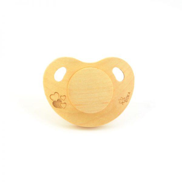 Suce en bois Boka avec petit coeur un produit de Arboreka